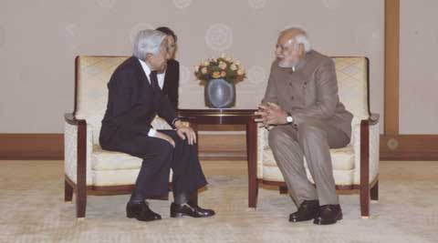 In this photo released by Imperial Household Agency of Japan, Japan's Emperor Akihito, left, talks with Indian Prime Minister Narendra Modi, right, during the audience at the Imperial Palace in Tokyo Tuesday, Sept. 2, 2014. (Source: AP)