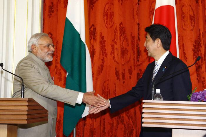 Narendra Modi, left, shakes hands with Japanese Prime Minister Shinzo Abe after a Japan-India Joint press conference at Akasaka State Guesthouse in Tokyo Monday. (Source: PTI)