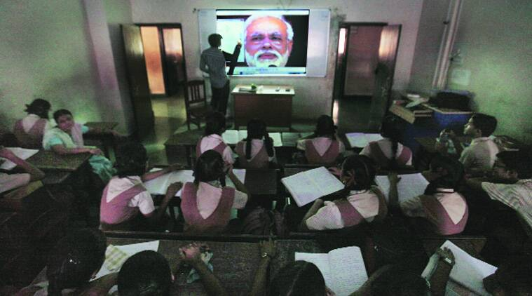 Preparations under way for the screening of Narendra Modi's speech at Kamraj Memorial School, Dharavi. (Source: Express photo by Vasant Prabhu)