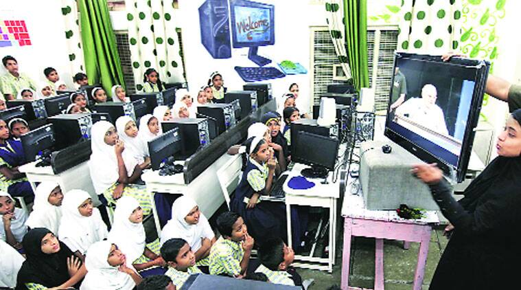 Students watch PM's speech on Teachers' Day at Dr Babasaheb Ambedkar Urdu and Marathi Vidyalaya in Laxminagar near Parvati on Friday. (Source: Express photo by Pavan Khengre)