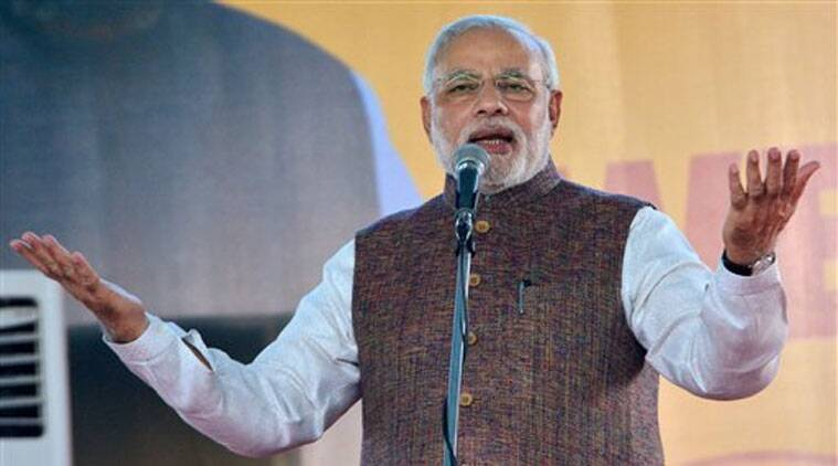 Prime Minister Narendra Modi addresses people on his arrival in Ahmedabad on Tuesday. (Source: PTI Photo)