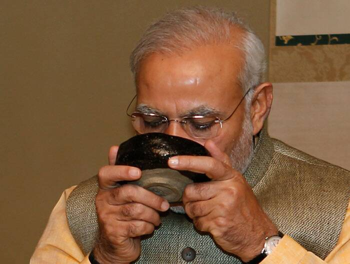 Prime Minister Narendra Modi drinks a bowl of green tea during a tea ceremony at a tea hut of the Omotesenke, one of the main schools of Japanese tea ceremony, in Tokyo Monday (September 1). Modi was on his official visit to Japan. (Source: AP)