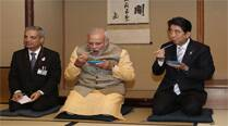 PM signal: sitting down with Japan, standing up to China