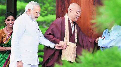 'I'm Modi and you are Mori': This is how Prime Minister Narendra Modi charmed the 83-year-old  head priest Yasu Nagamori (left) of Kinkakuji (Golden  Pavilion) —  an ancient 14th century Buddhist temple — in Kyoto on Sunday. (Source: PTI)