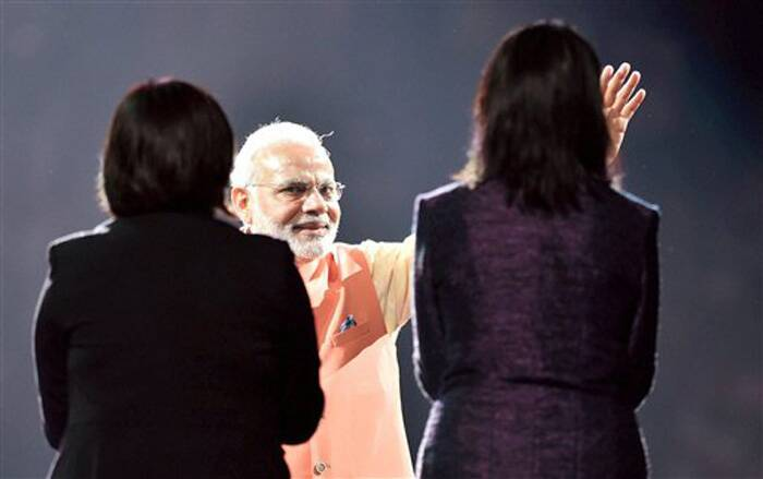 Prime Minister Narendra Modi waves at crowd during a reception organised in his honour by the Indian American Community Foundation at Madison Square Garden in New York on Sunday. (Source: PTI)