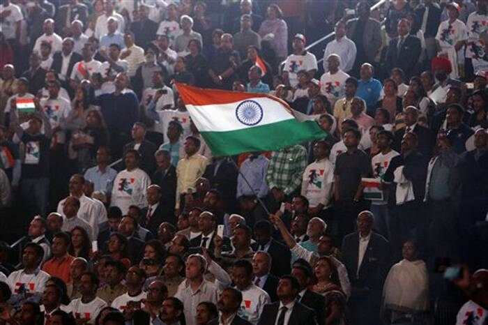 Supporters wave an Indian flag as Prime Minister Narendra Modi prepares to address during a reception organised in his honour by the Indian American Community Foundation at Madison Square Garden in New York on Sunday. (Source: PTI)