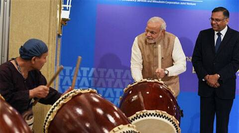 Prime Minister Narendra Modi beats a traditional Taiko drum during inauguration of the Tata Consultancy Services (TCS) Japan Technology and Culture Academy in Tokyo on Tuesday. TCS CEO N Chandrasekaran is also seen.(PTI Photo)