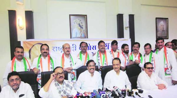 NCP leaders with the Independent MLAs who joined the party Monday. ( Source: Express photo by Ganesh Shirsekar )
