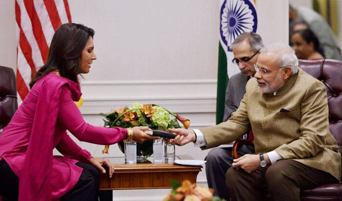 Influential lawmaker Tulsi Gabbard, the only Hindu member of the US Congress, met Prime Minister Narendra Modi in New York and presented her personal copy of Bhagavad Gita to him, saying it was a gesture to express her love for India. (Source: PTI)