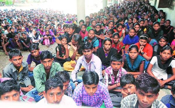 Students watch Prime Minister Narendra Modi's speech on television in Narmada, Gujarat on Teachers' day.