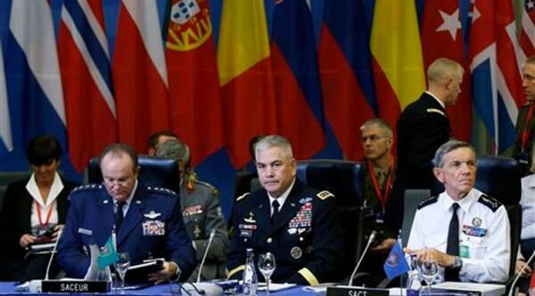 NATO's Supreme Allied Commander Europe (SACEUR) U.S. Gen. Philip M. Breedlove, left, U.S. Army Commander for International Security Assistance Force (ISAF), Gen. John F. Campbell, center, and NATO's Supreme Allied Commander Transformation (SACT) Gen. Jean-Paul Palomeros, right, attend a NATO Military Committee Conference in Vilnius, Lithuania. Source: AP photo