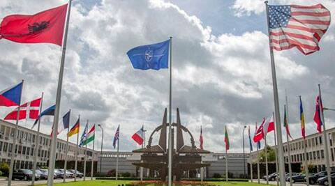 Flags of member nations flap in the wind outside NATO headquarters in Brussels. NATO urged Russia to cease its military actions and take immediate and verifiable steps towards de-escalation of the crisis in Ukraine. (Source: AP)