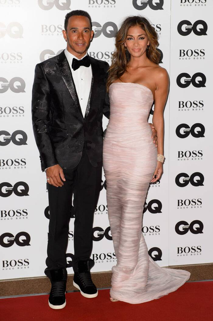 Nicole Scherzinger was gorgeous in a strapless Ermanno Scervino gown as she arrived with beau Lewis Hamilton. (Source: AP)