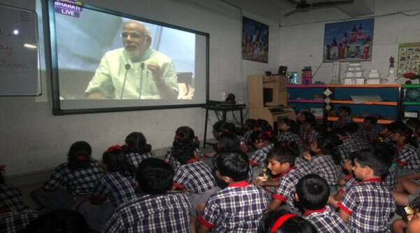 School students watching Prime Minister Narendra Modi address being projected on big screen on the occasion of Teachers' Day. (Source: Express photo by Partha Paul)
