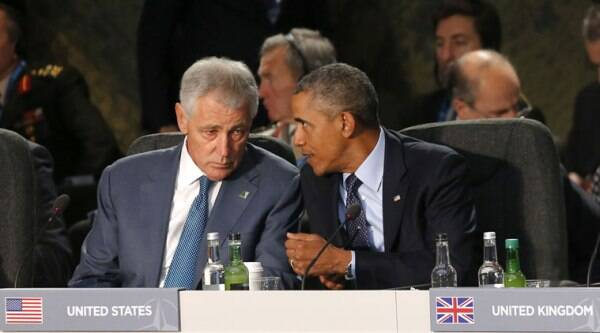 U.S. President Barack Obama speaks with U.S. Defense Secretary Chuck Hagel at a leaders meeting on the future of NATO at Celtic Manor, Newport, Wales, Friday, Sept. 5, 2014. (Source: AP)