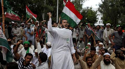 Supporters of anti-government Muslim cleric Tahir-ul-Qadri chant slogans during a protest close to Prime Minister's home in Islamabad, Pakistan on Monday, Sept. 1, 2014. (Source: AP)