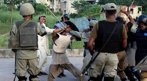 Police beat a protester during clashes in Islamabad, Pakistan. (Source: AP)