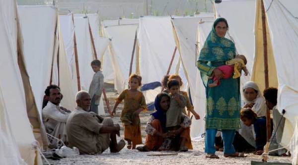 Pakistani flood affected villagers settle in a relief camp in Jhang, Pakistan. Pakistani troops used helicopters and boats to evacuate thousands of marooned people from the country's plains. (Source: AP)