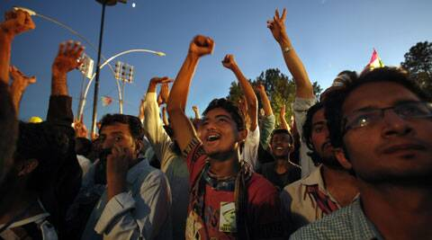 Supporters of Pakistan's fiery cleric Tahir-ul-Qadri chant slogans during a protest near Prime Minister's home in Islamabad on Tuesday. (Source: AP)
