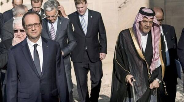 French President Francois Hollande, left, leaves with Saudi Arabian Foreign Minister Prince Saud al-Faisal, after a family photo at the International conference intended to come up with an international strategy against Islamic State extremists, in Paris. Source: AP photo