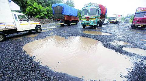 Potholes have come up on Mahape-Shil-Phata stretch after heavy rain in Navi Mumbai for the last two days. (Source: Express photo by Narendra Vaskar)