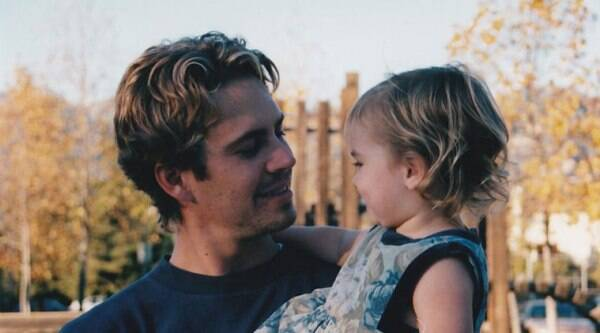 Meadow posted a photo of her as a toddler being held by her dad.