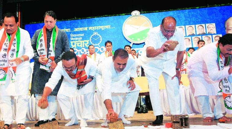 From left: NCP leaders  Ajit Pawar, Dilip Walse-Patil, Chhagan Bhujbal, Praful Patel, Sharad Pawar and Sunil Tatkare break coconuts to launch the party's campaign for Assembly elections, in Mumbai on Saturday. (Source: Express photo by Ganesh Shirsekar)