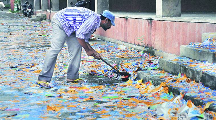 Leaflets being removed a day after student's election at PU's Law Auditorium. (Source: Express photo by Sahil Walia)