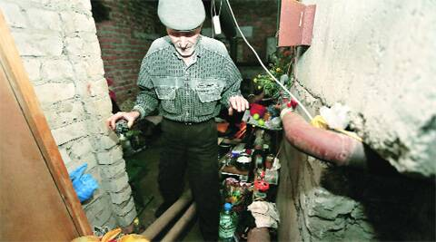 A man in the basement of his house, used as a bomb shelter in the town of  Ilovaisk, eastern Ukraine, Sunday.(Source:  AP)