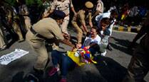 Tibetans stage protest with anti-China slogans outside Taj Palace