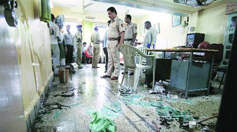 Police at the ransacked CPM office at Narayan Peth on Tuesday. ( Source: Express photo by Arul Horizon )