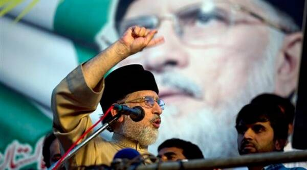 Pakistan's fiery Muslim cleric Tahir-ul-Qadri addresses his supporters outside the parliament building in Islamabad, Pakistan. Source: AP photo