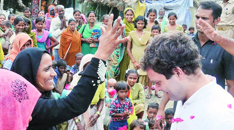 Rahul interacts with villagers in Amethi, Thursday. (Source: Express photo by PTI)