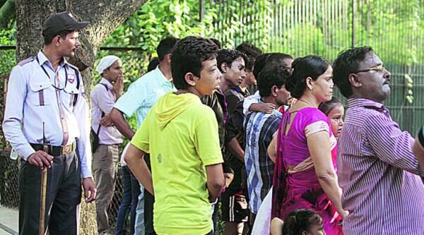 Visitors crowd around the white tiger enclosure in Delhi zoo. (Source: Express photo by Amit Mehra)