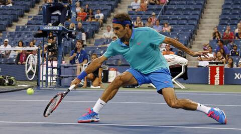 Roger Federer, of Switzerland, stretches for a volley against Marcel Granollers, of Spain, in the third round (Source: AP)