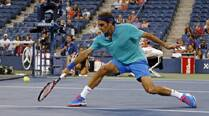 US Open: Roger Federer marches on