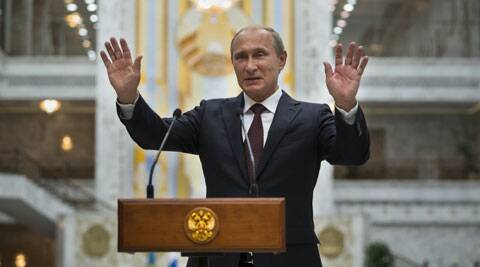 Russian President Vladimir Putin gestures while speaking to the media after his talks with Ukrainian President Petro Poroshenko in Minsk, Belarus, Wednesday, Aug. 27, 2014. (Source: AP)