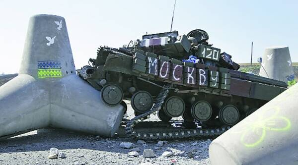 A destroyed Ukrainian army tank near the village of Lebedynske, on the highway joining Mariupol and Novoazovsk Saturday. (Source: AP)