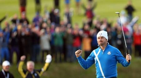 Europe's Graeme McDowell celebrates putting out to win the match 3 and 2 to play during the foursomes match on the first day of the Ryder Cup golf tournament. (Source: AP)
