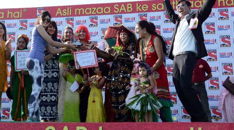 SAB TV stars awarding the winners of SAB Family Funathon for  'Best Anokhi Costume Family'