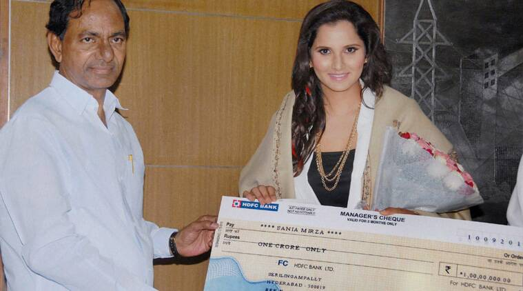 Telangana CM K Chandrashekhar Rao felicitates Sania Mirza with a cheque of Rs 1 crore in Hyderabad on Thursday. (Source: PTI)