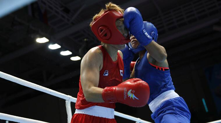 OOUCH! South Korea's Park Ji-na (red) fights with India's Laishram Sarita Devi during their women's light (57-60kg) semi-final (Source: Reuters)