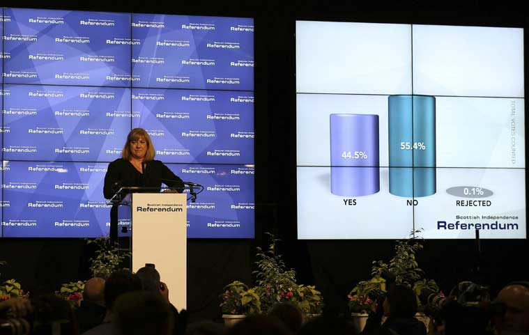 Chief Counting Officer Mary Pitcaithly declares the result of the Scottish independence referendum in Edinburgh, Scotland, Friday, Sept. 19, 2014. (Source: AP photo)