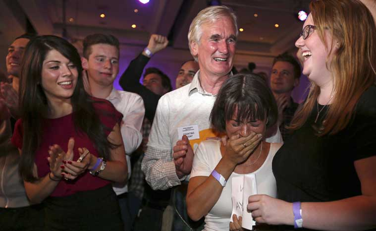 No supporter Joanna Baxter from Ayrshire, second right, reacts to results in the Scottish independence referendum at the Marriott Hotel in Glasgow, Scotland as ballet papers are counted through the nigh Friday, Sept. 19, 2014. (Source: AP photo)