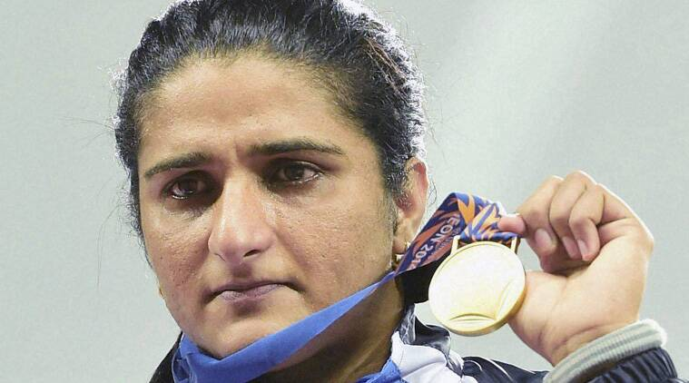 On the podium, Seema wept as the national anthem echoed through an almost-empty Main Asiad Stadium. (Source: PTI)