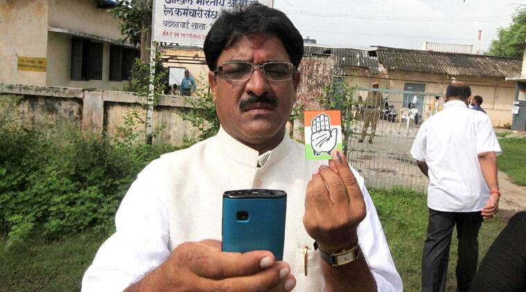 Vadodara Lok Sabha bypolls Congress candidate, Narendra Ravat, captures a selfie with the party symbol after casting his vote at the Sayajigunj polling station in Vadodara on Saturday. (Source: Bhupendra Rana)