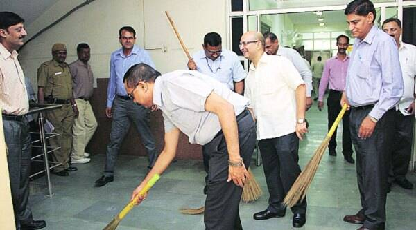Top Crime Branch officers cleaning its Kamla Market headquarters on Monday as part of the Swachh Bharat Abhiyan.