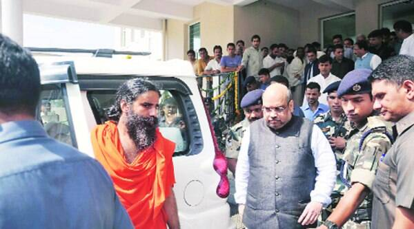 Ramdev and Amit Shah in Hardwar Sunday.
