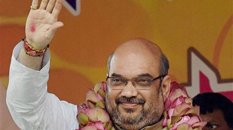 BJP President Amit Shah waves during a rally in Kolkata on Sunday. (Source: PTI)