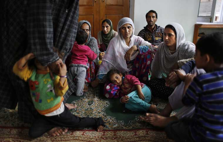 A rescued Kashmiri family takes shelter at a makeshift relief camp set up at a mosque in Srinagar, Indian-controlled Kashmir, Thursday, Sept. 11, 2014. (Source: AP photo)